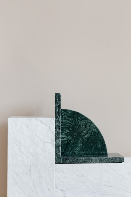 Stylish green bookend on marble table