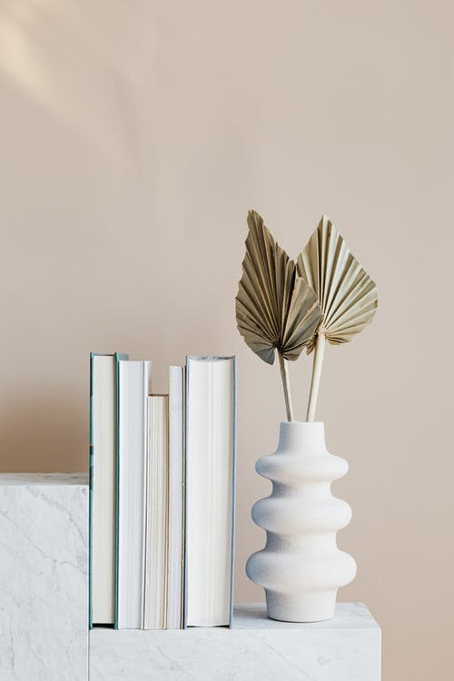 Geometric marble shelf with books and decorative vase