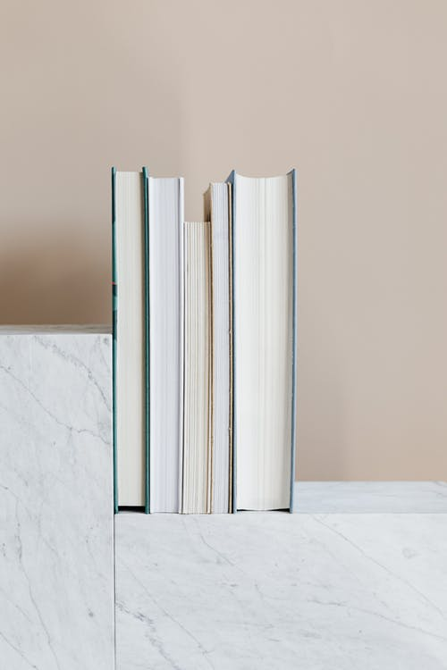 Set of books on marble geometric stand