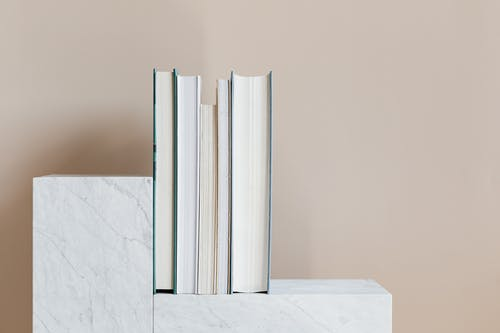Set of books placed on marble shelf