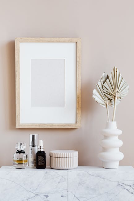 Stylish minimalistic composition of cosmetics vase and wall frame
