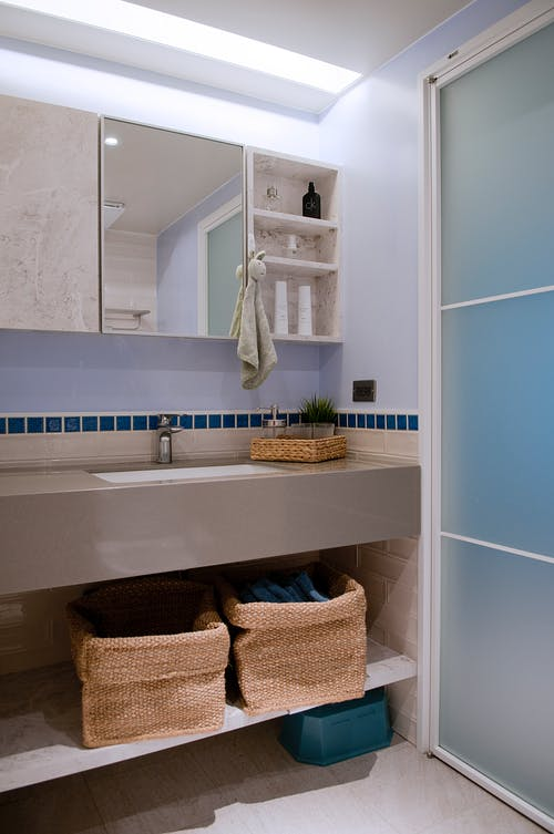 Mirror and hygienic supplies in bathroom