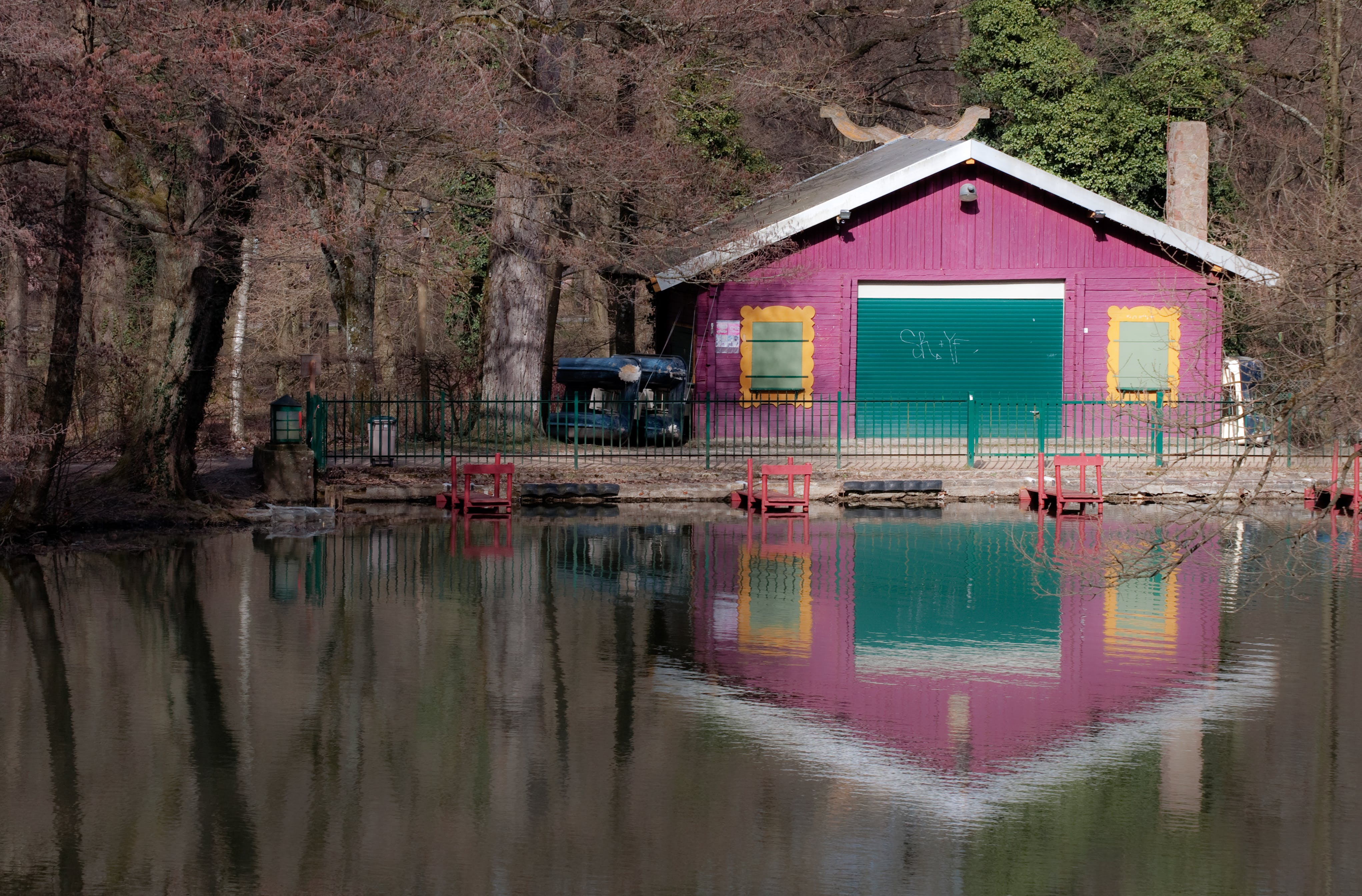 Calm Body of Water Near Pink Painted House