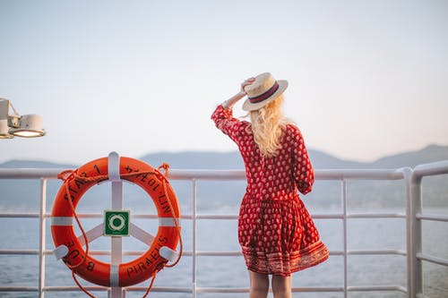 Woman in Red Dress Looking at the Sea