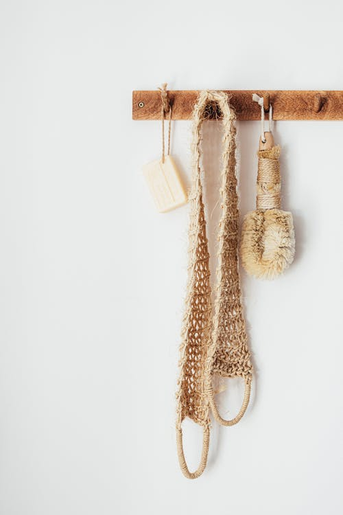 Wooden hanger with eco friendly bathroom accessories