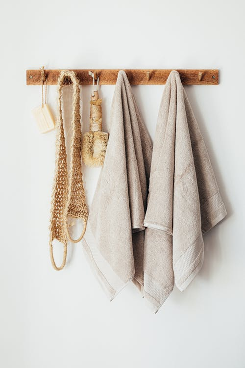 Set of body care tools with towels on hanger