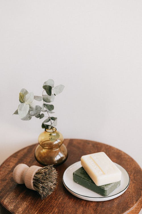 Bamboo shaving swab and soaps on wooden table