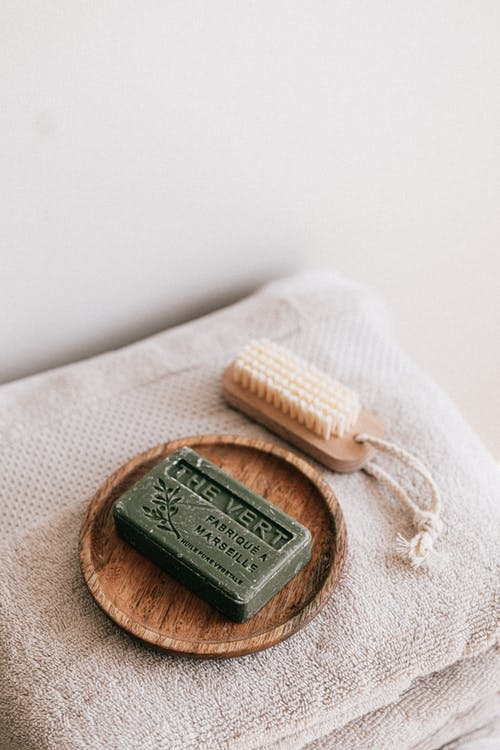 Stack of natural soap brush and towels