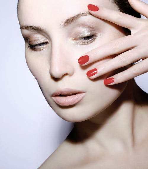 Woman With Red Manicure
