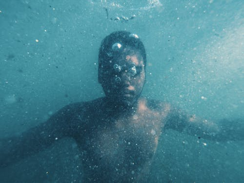 Photo of Man Swimming Underwater