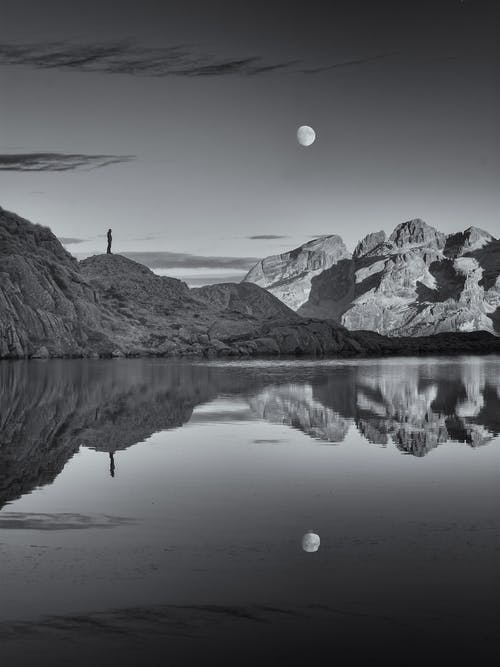 Grayscale Photo of Lake and Mountains