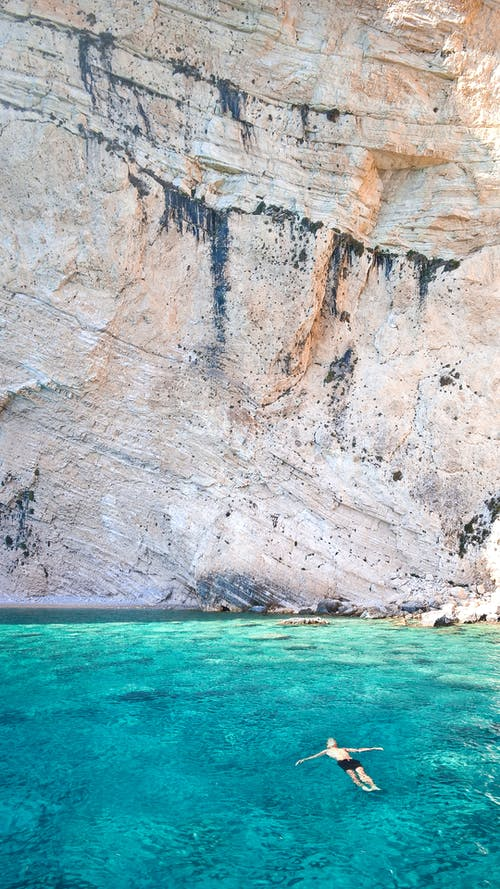 Gratis lagerfoto af afslappende, ferie, hav, klippe