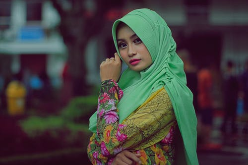 Photo of Woman Wearing Green Hijab and Floral Dress