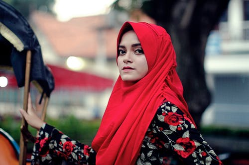 Woman in Red Hijab and Floral Dress