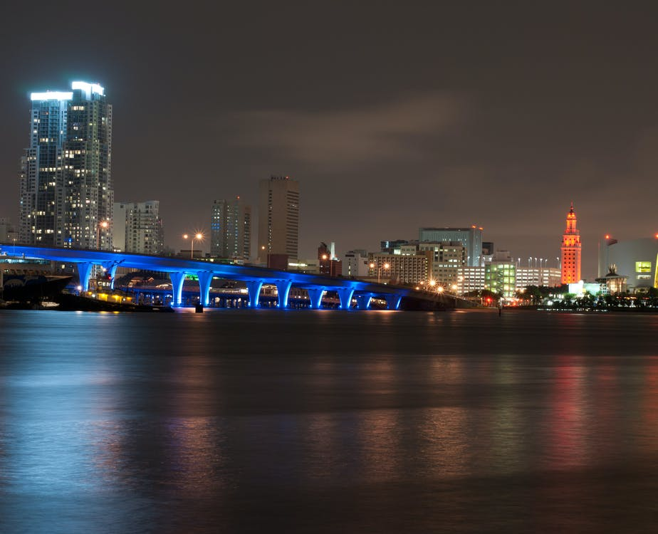 Bridge and Urban City at Nighttime