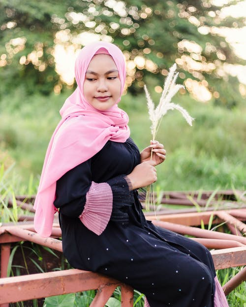 Woman in Pink Hijab and Black Dress
