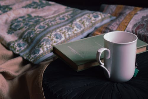 Mug and book placed on table