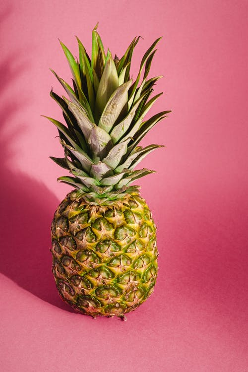 Pineapple Fruit on Pink Textile