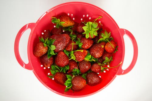 Strawberries in Red Bowl