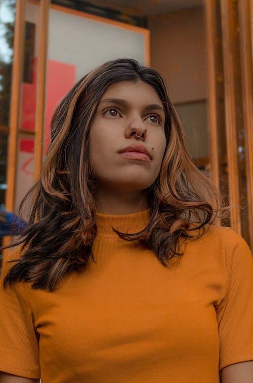 Woman in Orange Turtleneck Shirt