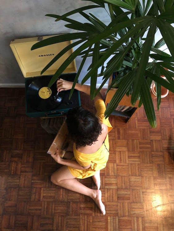 High Angle Photo of Woman Sitting on Floor