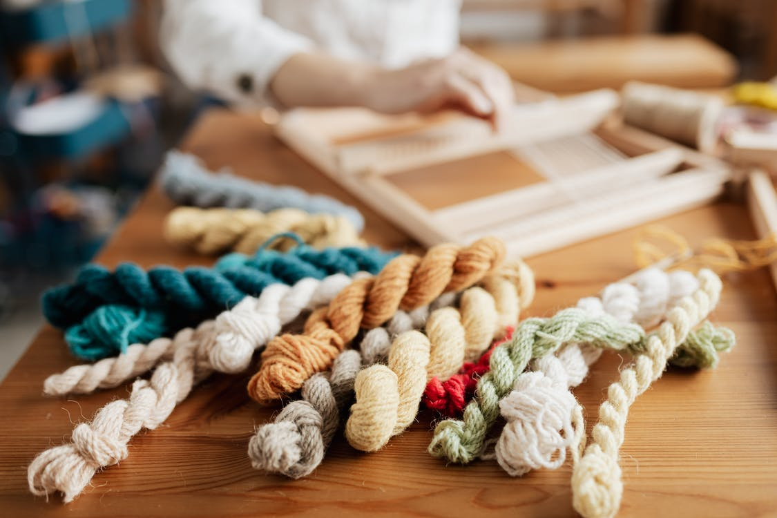 Close-Up Photo of Ropes on Wooden Table
