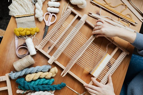 Top View Photo of Person Weaving