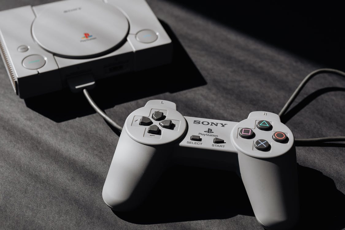 Photo of Play Station Game Console and Remote Controller