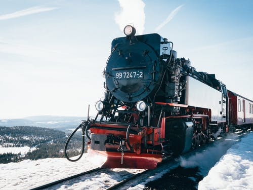 Black and Red Train on Snow Covered Ground
