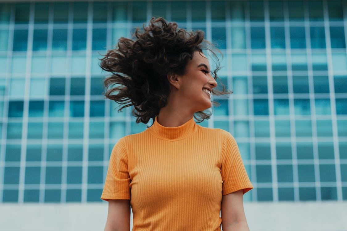 Woman in Orange Crew Neck T-shirt