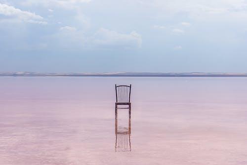 Brown Wooden Chair on Beach