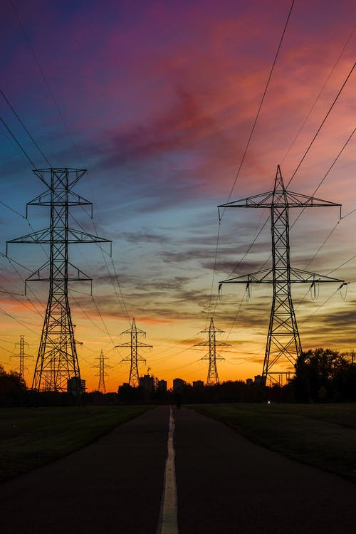 Silhouette Photo of Transmission Lines During Golden Hour