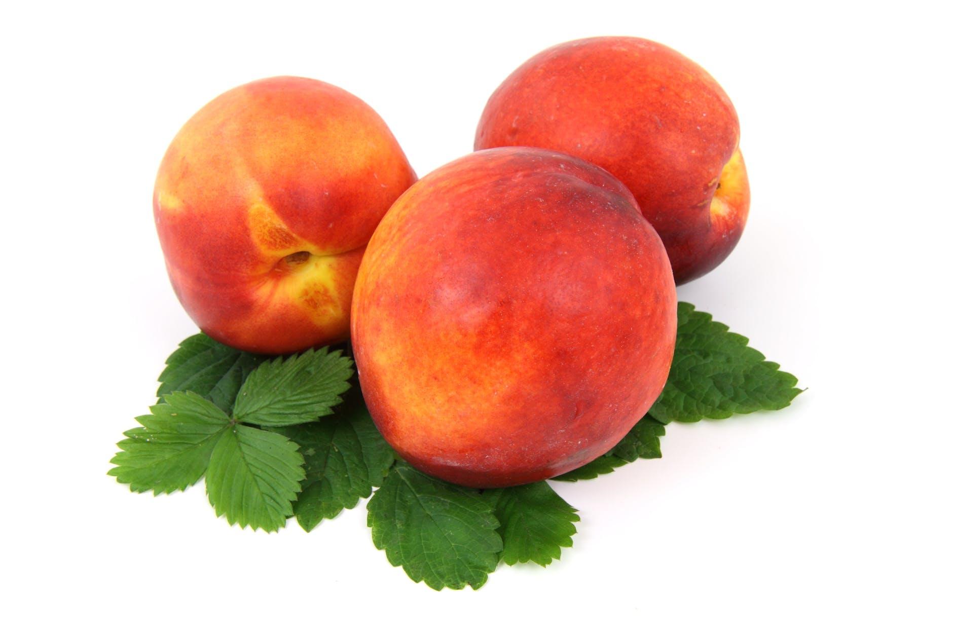 three peaches on white background