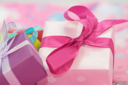 White and Purple Gift Box With Pink and White Ribbon