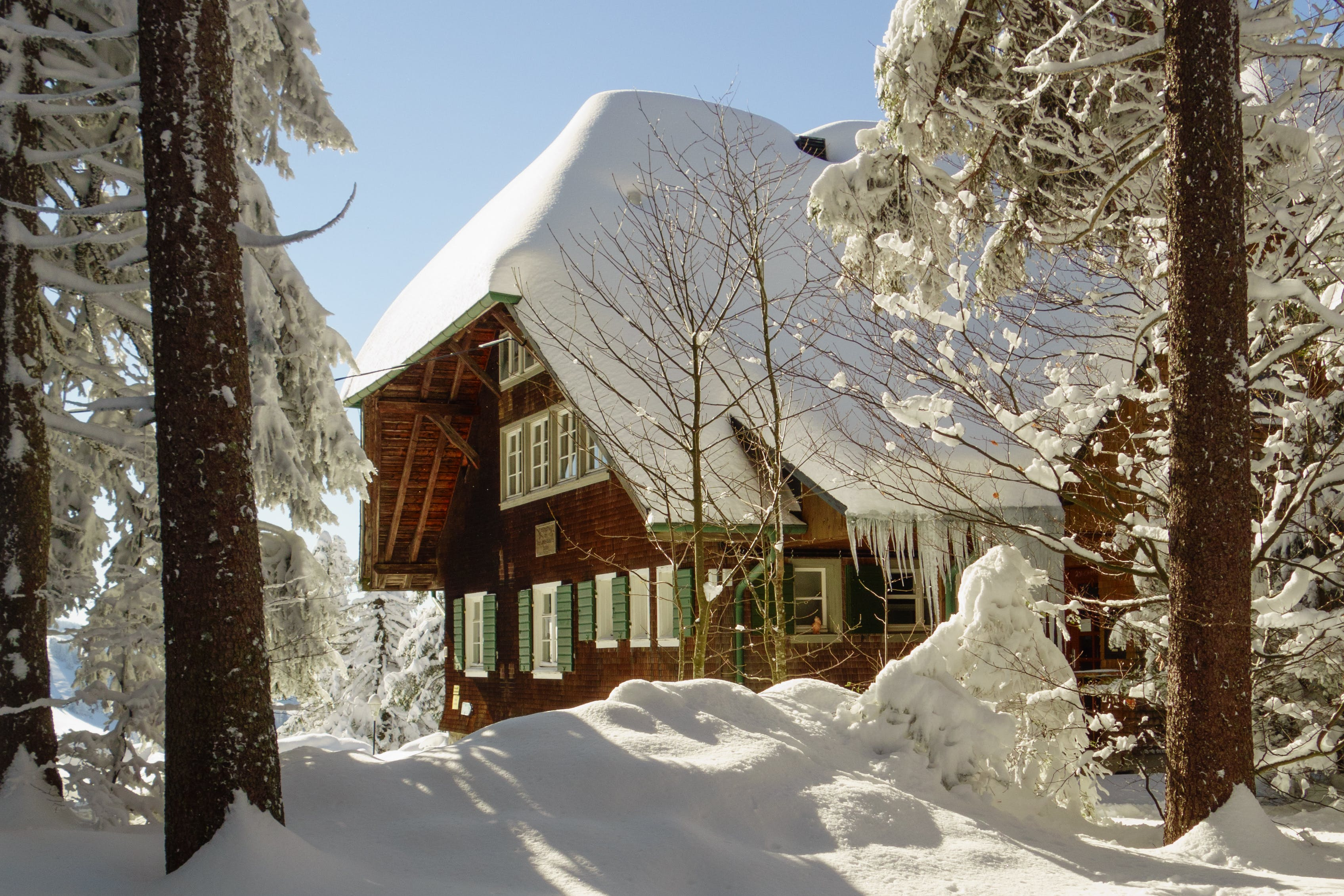 Brown and White Wooden House Covered With Snow