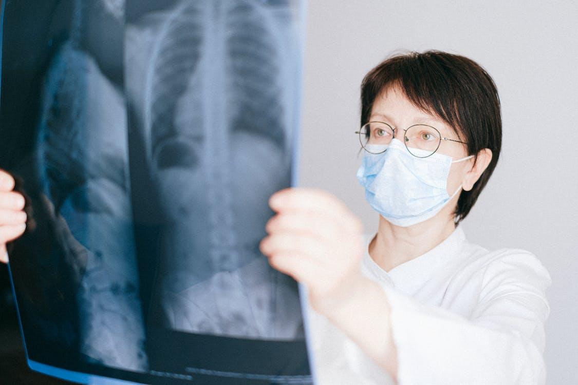 Woman in White Long Sleeve Shirt Wearing Eyeglasses