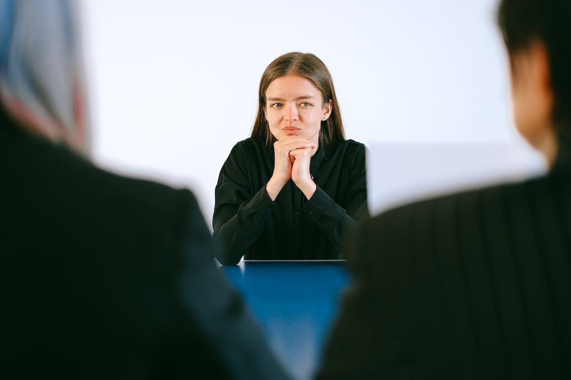 Woman in Black Blazer Sitting Being Interview