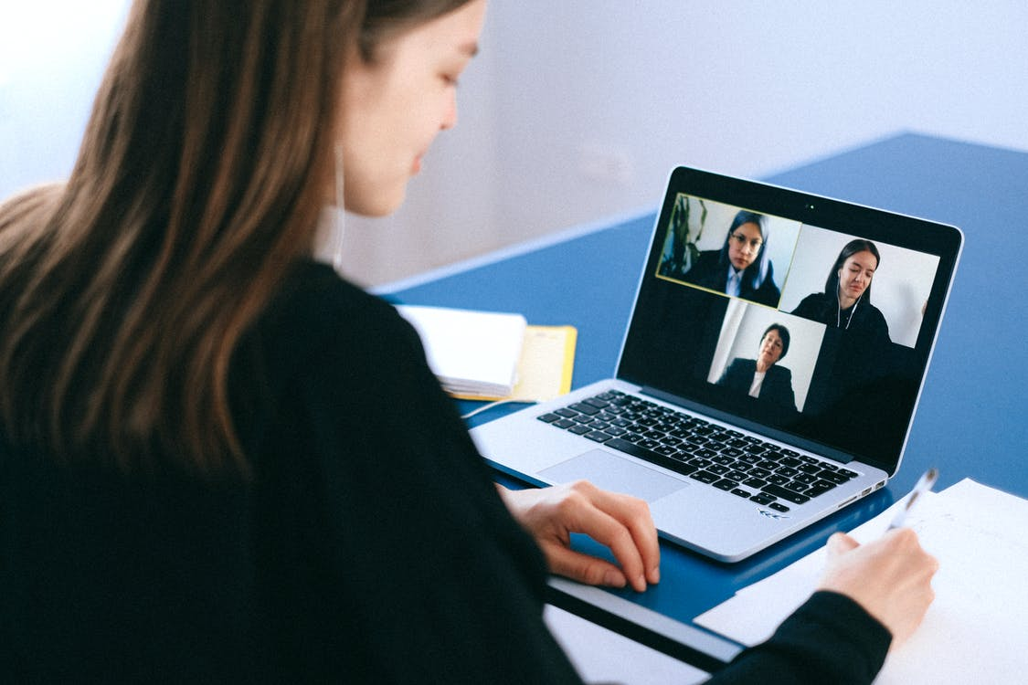 People on a Video Call working remotely catalog management software