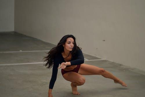 Focused female dancer practicing in room