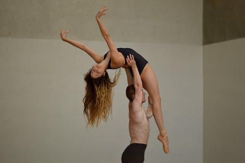 Dancers demonstrating dance lift in studio