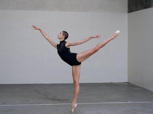 Focused ballerina training in studio