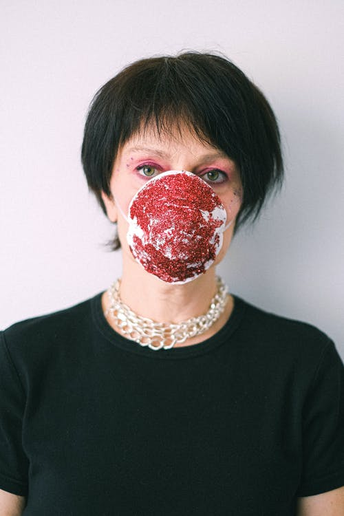 Woman Wearing a Face Mask with Glitter