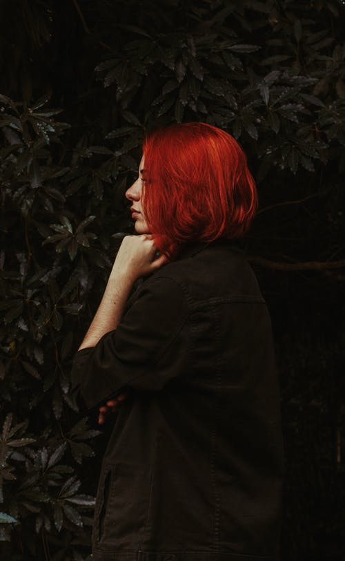 Young serious woman with bright ginger hair