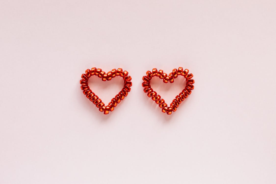 Set of colorful hearts on pink background
