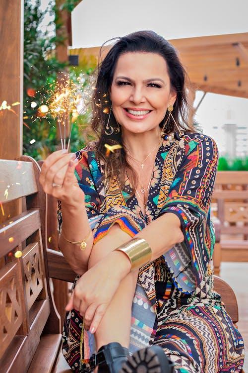 Cheerful woman enjoying sparkling Bengal light
