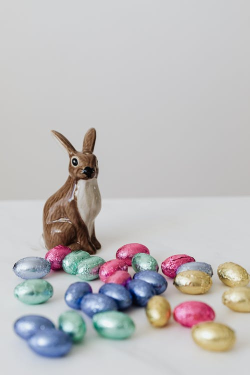 Brown Ceramic Rabbit And Chocolate Eggs
