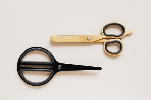 Set of various scissors on beige surface