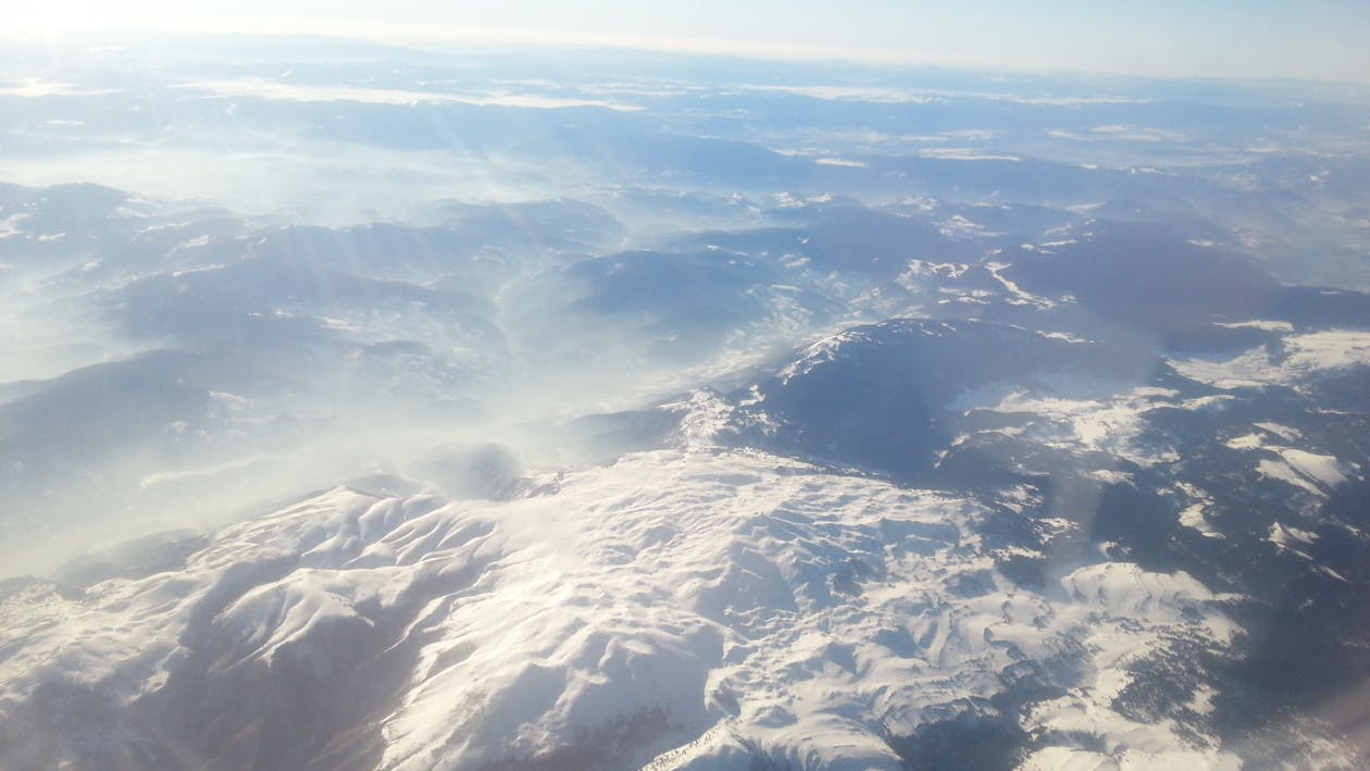 Free stock photo of airplane puffs, flying, mountains