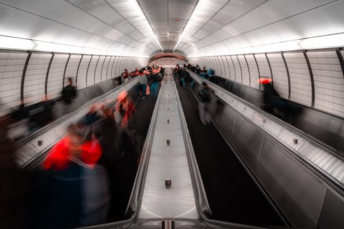 Anonymous people on escalator in modern subway