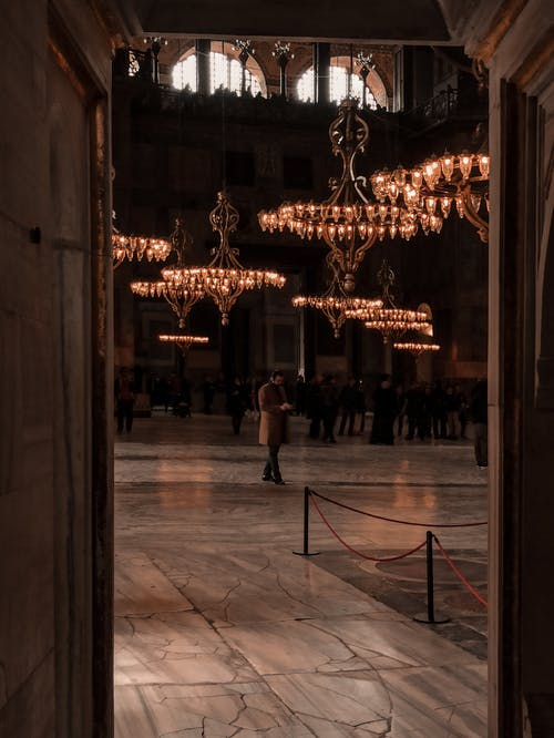 Interior of old mosque with classic chandeliers